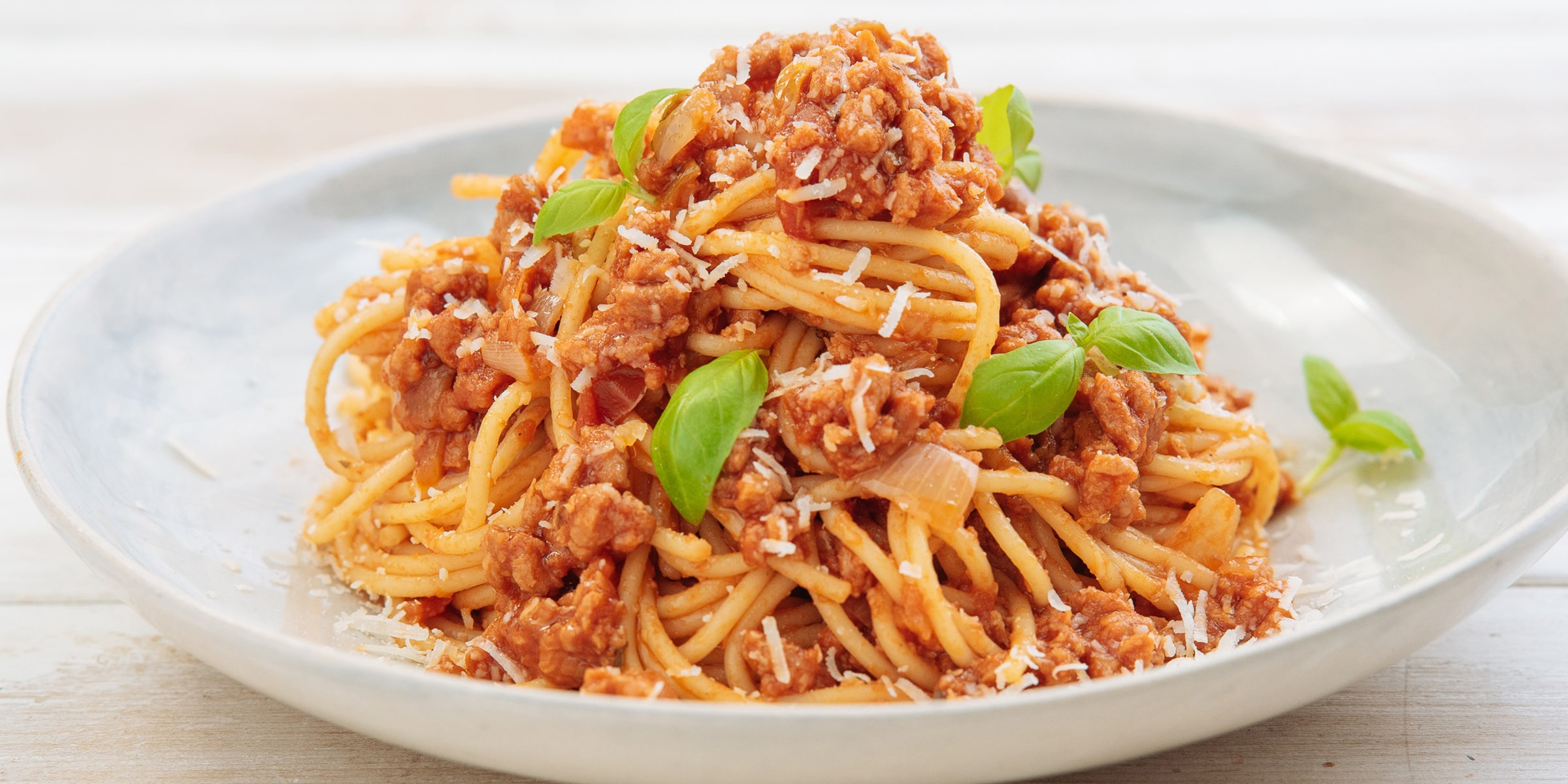 Meat-free spaghetti Bolognese with Meatless Farm mince, topped with Parmesan and herbs