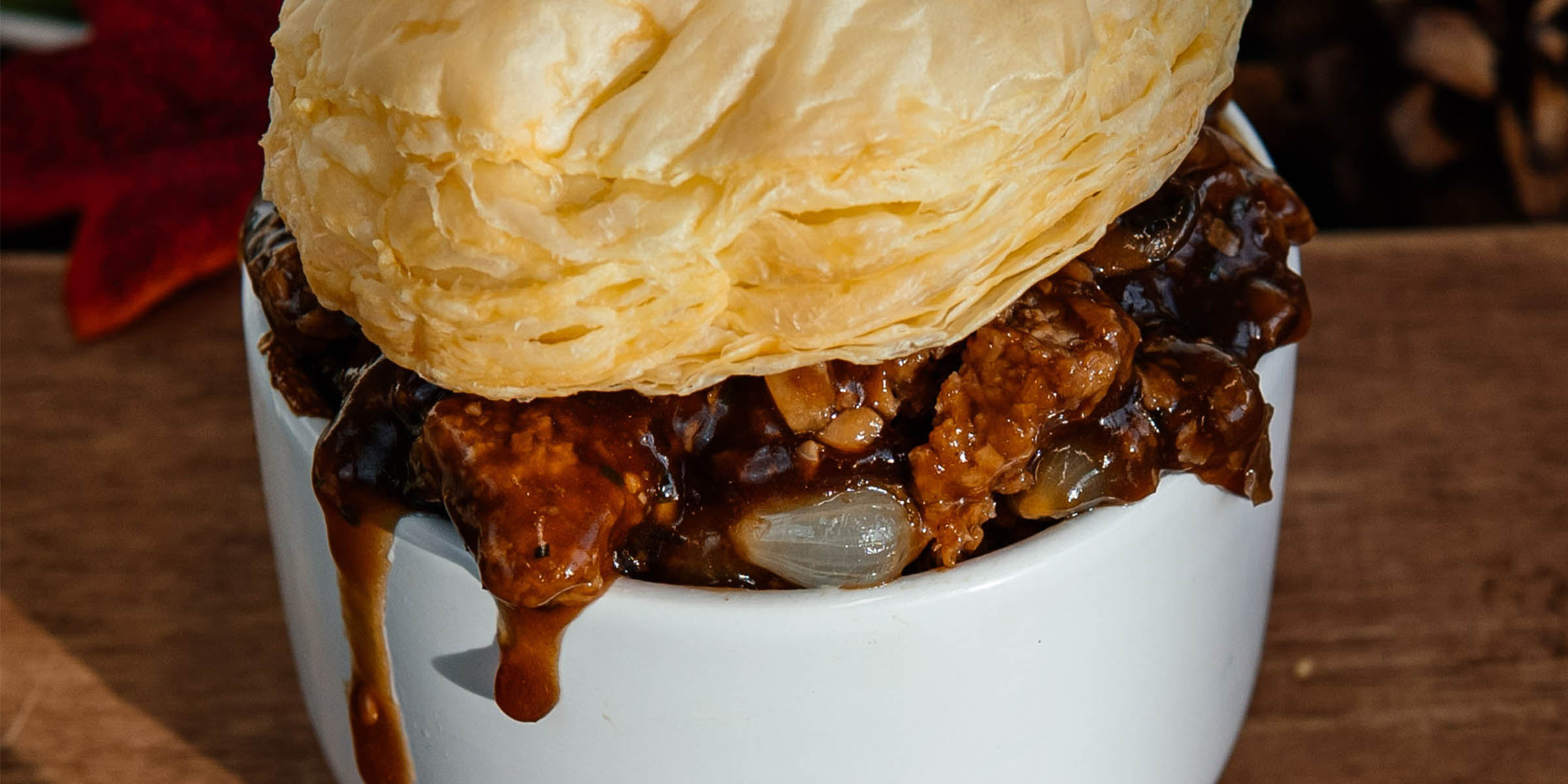 Meatless burger, mushroom and onion in gravy with a pastry top