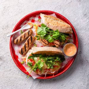Meat-free banh mi with Meatless Farm sausage and salad