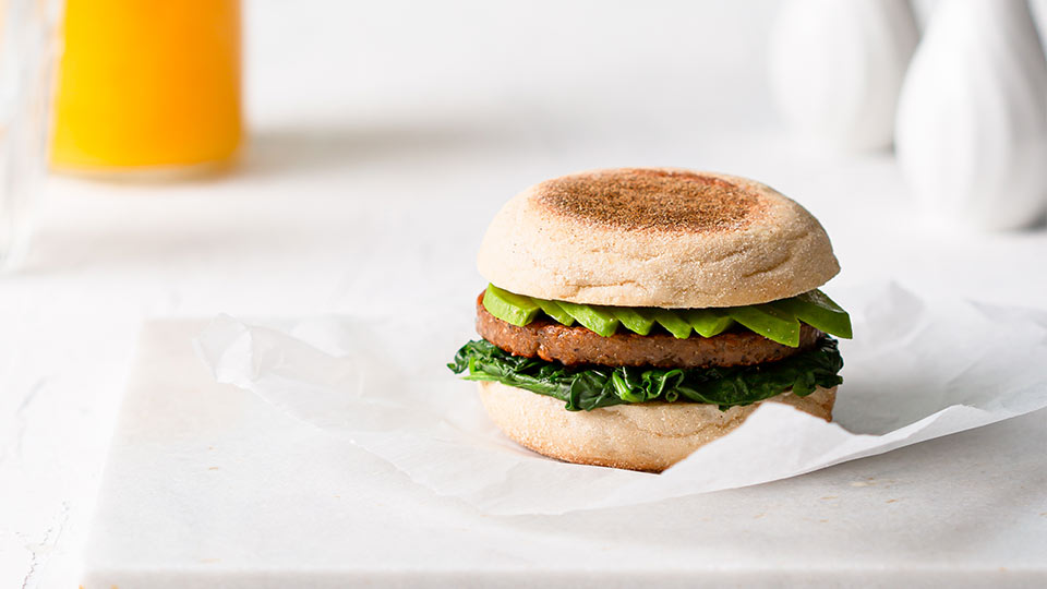 Muffin with Meatless sausage patty, avocado and spinach