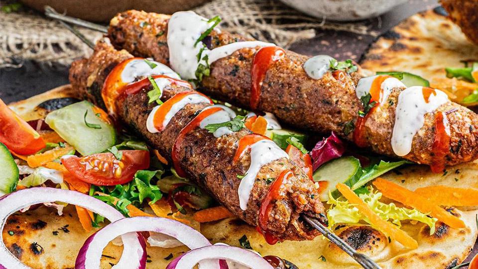 Meatless Farm plant-based kebab on flatbread with vegetables