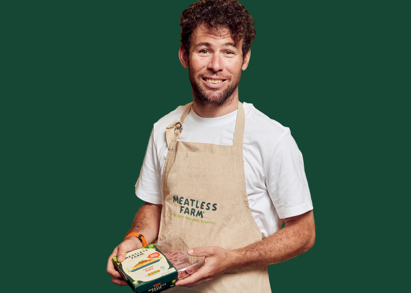 Mark Cavendish holding a pack of Meatless Farm